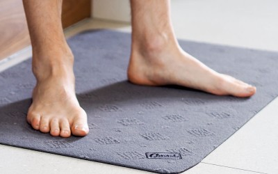 Person standing on Conni Floor Mat