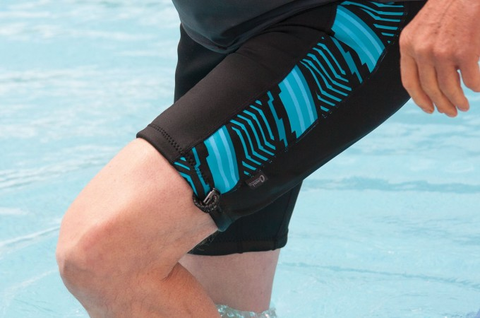 Person wearing Conni Containment Swim Shorts stepping out of pool