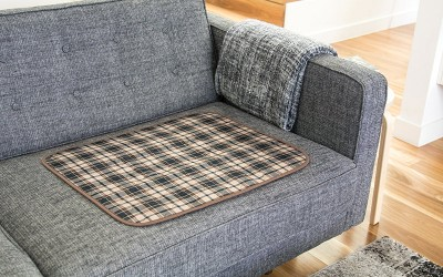 Conni Chair Pad in Tartan on Grey Couch